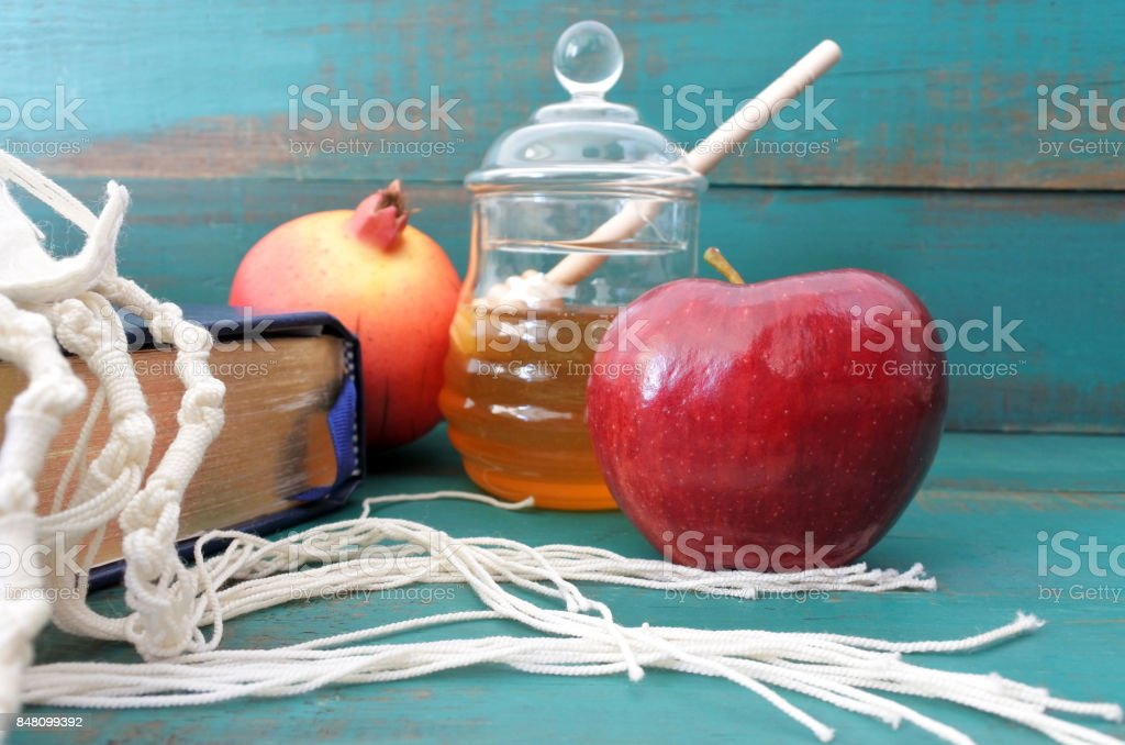 Torah book tallit pomegranate honey and apple background stock photo