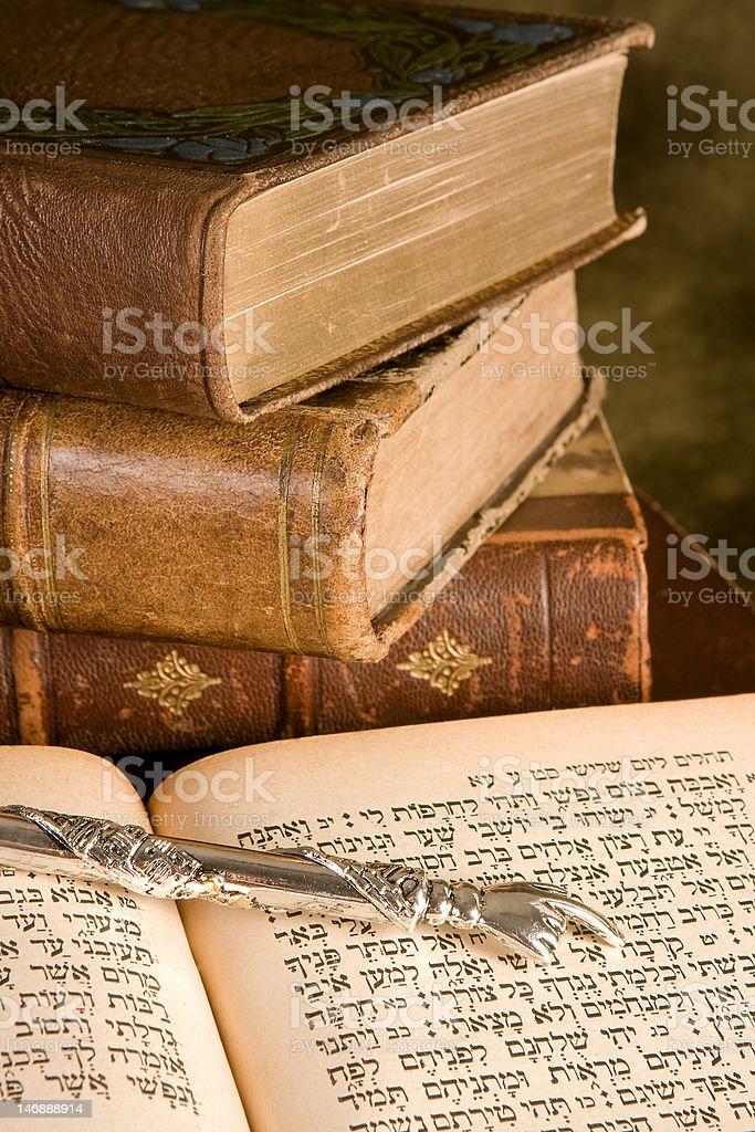 Torah pointer on books stock photo