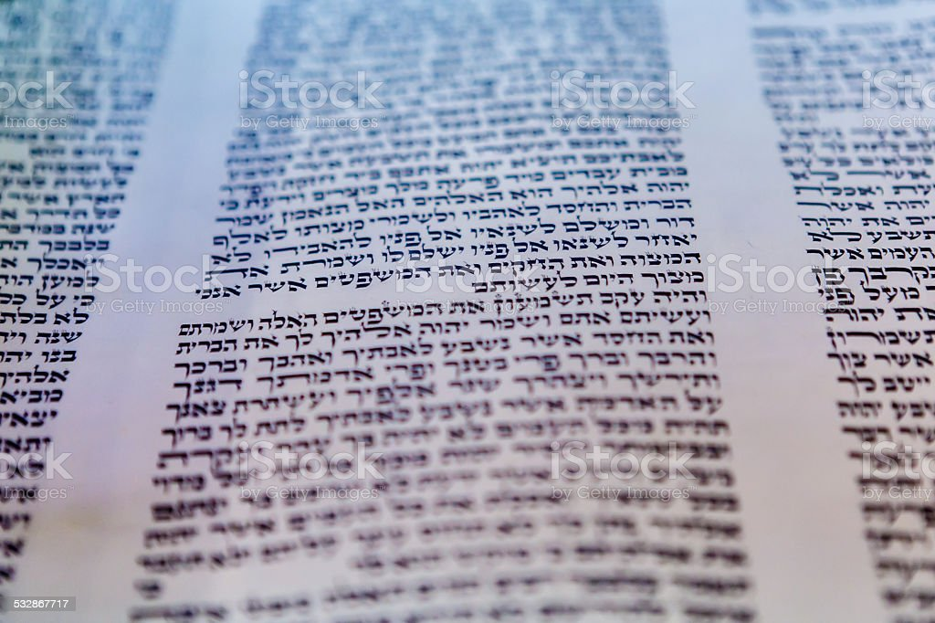 Torah scroll and yad on the Bimah in synagogue stock photo