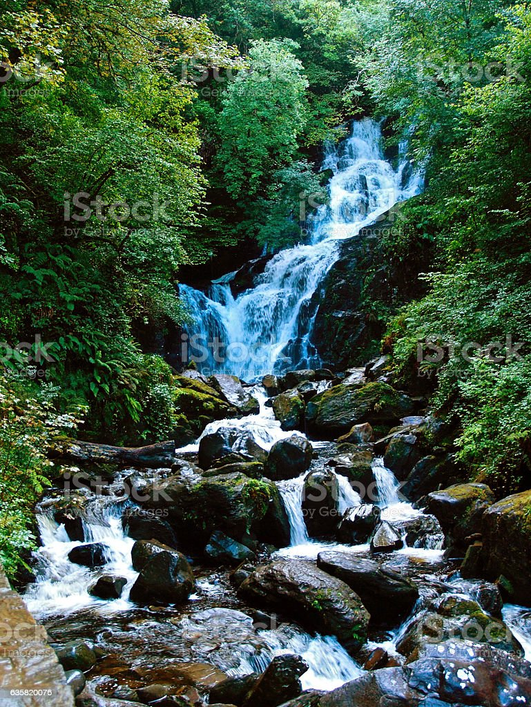 Torc Waterfall in Killarney National Forest in Ireland stock photo