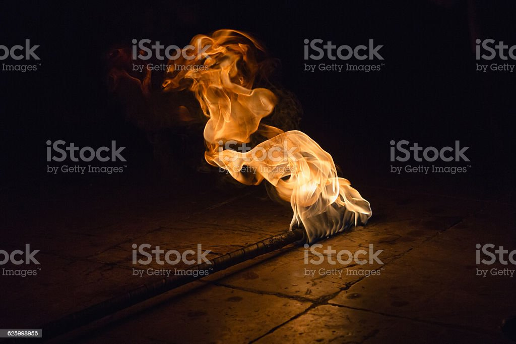 Torch in darkness stock photo