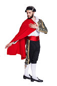 Toreador with a red cape.  Isolated on a white background