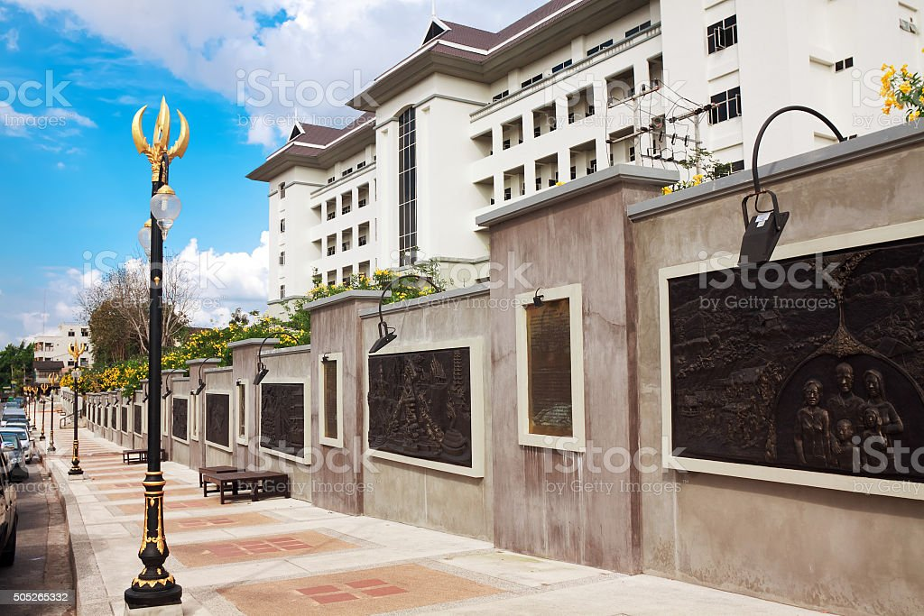 Toreutics on wall depicting historical milestones of Krabi provinct stock photo