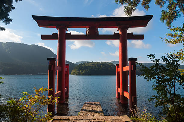 Torii Gate with a view of the sea beyond it The torii gate which stands on the shore of Lake Ashi, near Mount Fuji in Japan. torii gate stock pictures, royalty-free photos & images