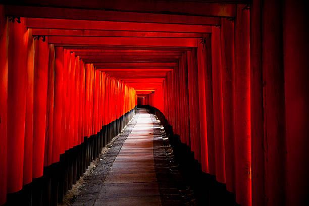 Torii gates in Fushimi Inari Shrine, Kyoto, Japan Kyoto, Japan - July 27, 2011: Torii gates in Fushimi Inari Shrine. Fushimi Inari Shrine also known as Fushimi Inari Taisha, is famous Shinto shrine in Kyoto. shinto shrine stock pictures, royalty-free photos & images