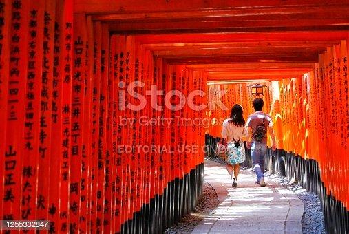Kyoto, Japan -  May 02, 2015 : Young japanese walking in the Fushimi Inari Taisha, The famous destination in Kyoto. Fushimi Inari-taisha is the head shrine of the kami Inari.