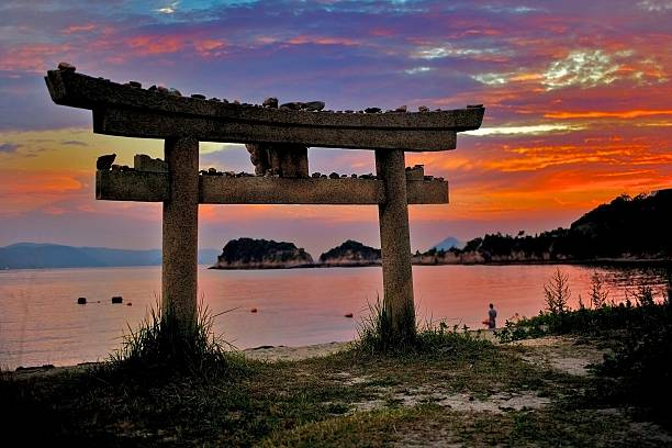 torii,Religion,Sunset,Japan,See,Landscape sacred Shinto gate at the edge of a beach Nao shima shinto shrine stock pictures, royalty-free photos & images