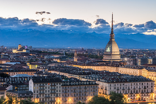 Torino Cityscape, Italia. Skyline panoramic view of Turin, Italy, at dusk with glowing city lights. The Mole Antonelliana illuminated, scenic effect.