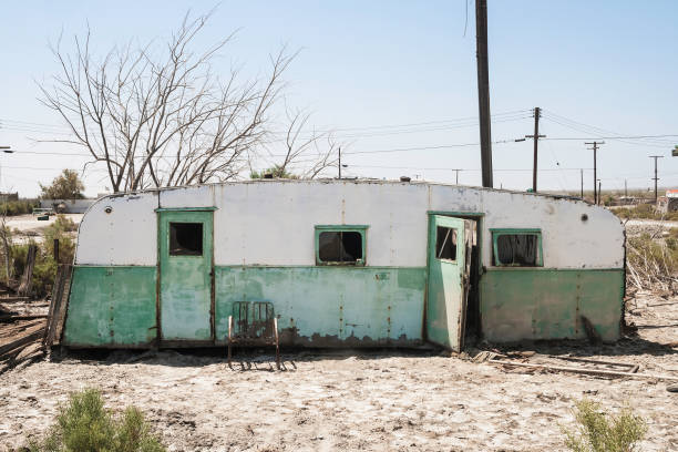 Torn and abandoned trailer in Salton Sea Beach, CA. A torn and abandoned trailer in Salton Sea, California - summer 2007. trailer park stock pictures, royalty-free photos & images