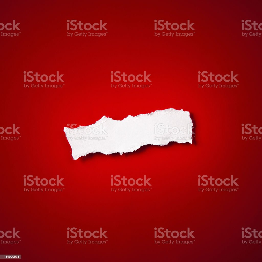 Torn blank piece of paper on red royalty-free stock photo