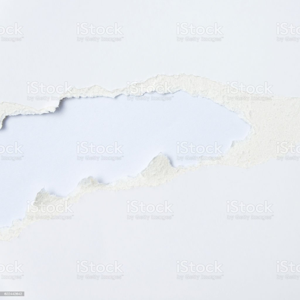 Torn blank white paper on white background stock photo