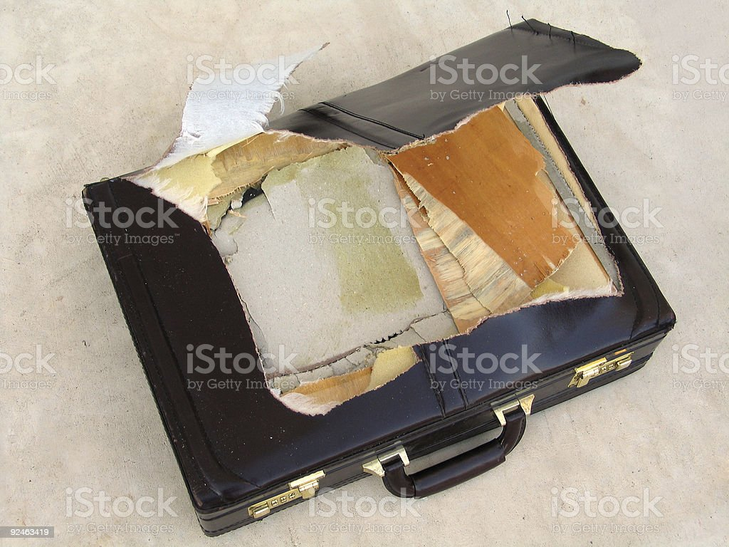 Torn Briefcase stock photo