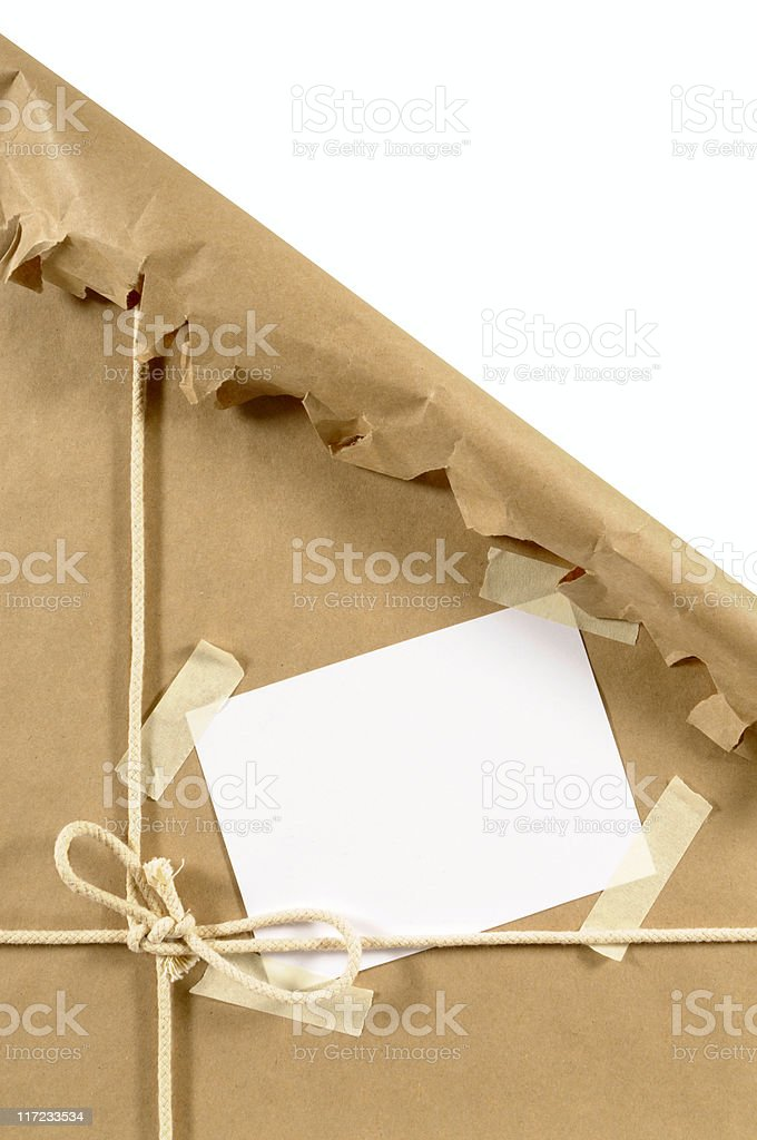 Torn brown paper package stock photo
