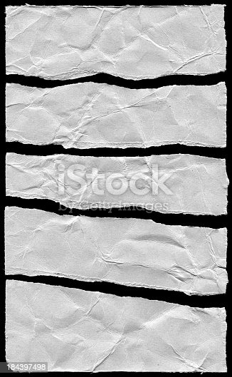 170011440 istock photo Torn cardboard paper textured isolated on black background 184397498