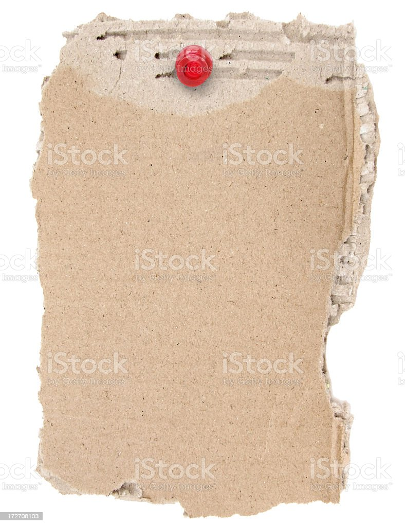 Torn Cardboard With A Pushpin royalty-free stock photo