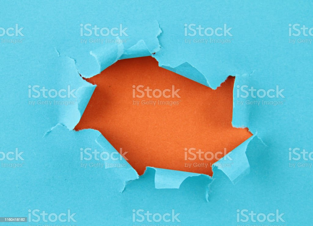 Torn colored paper, hole in the sheet of paper with copy space