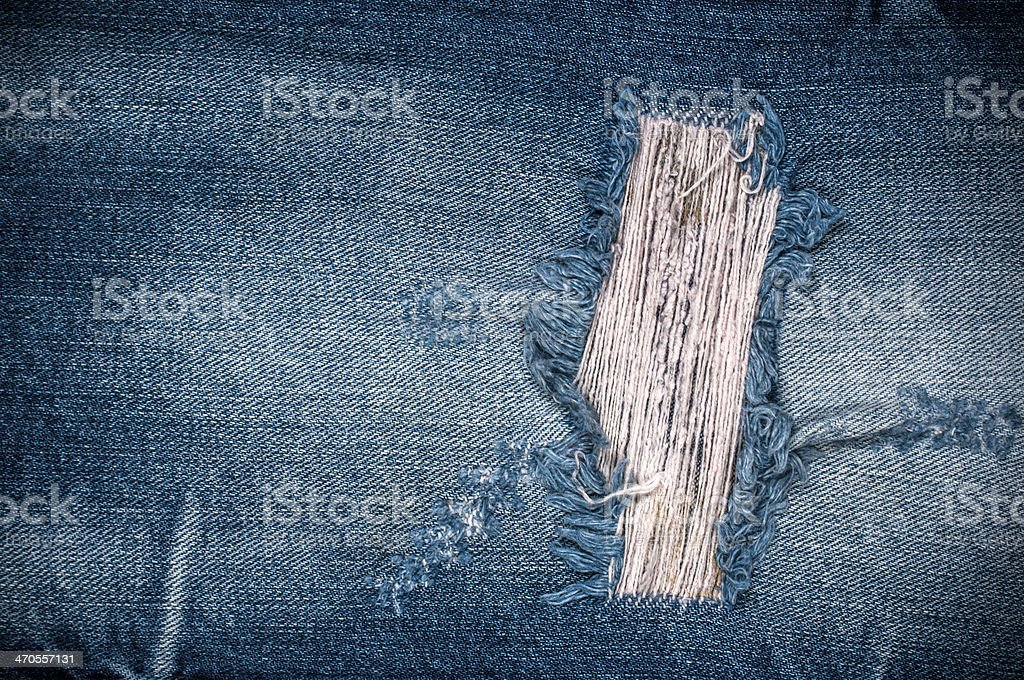 Torn denim texture stock photo