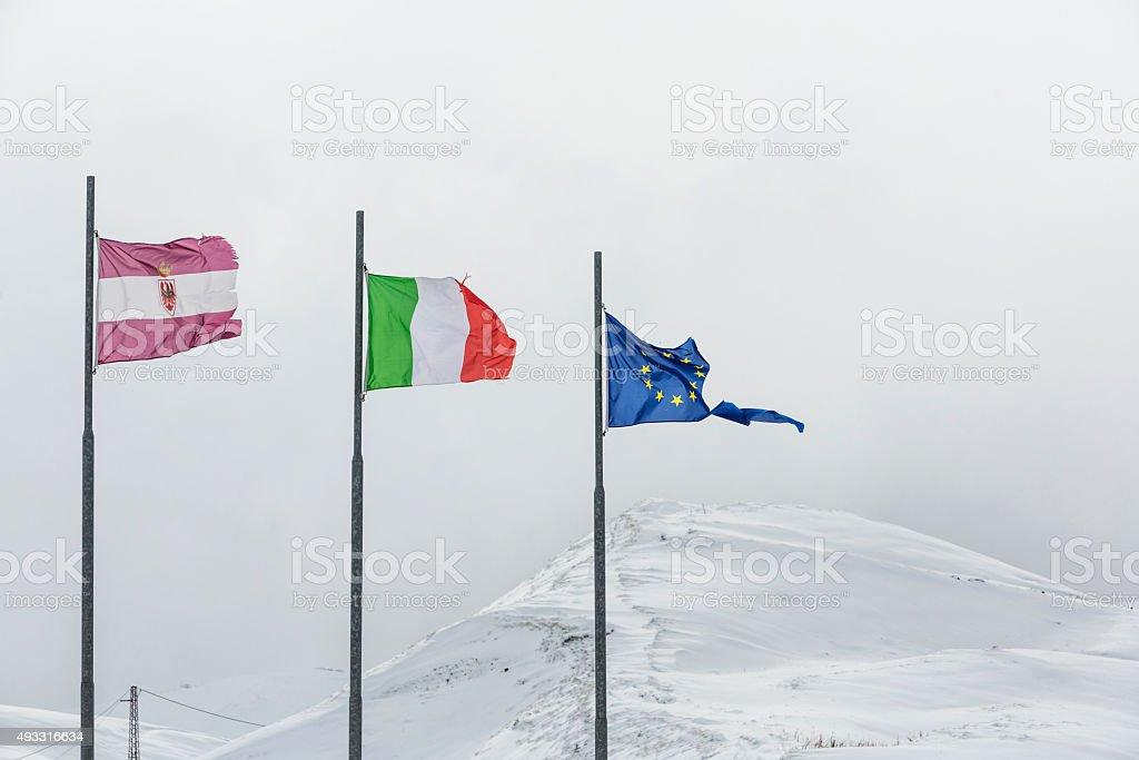 Torn European Union flag on white background stock photo