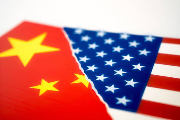 Torn flag of America and Chinese flag stock photo