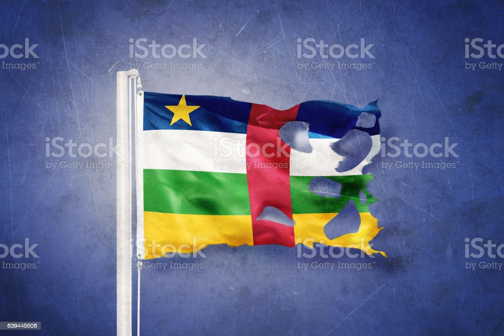 Torn flag of Central African Republic flying against grunge background stock photo