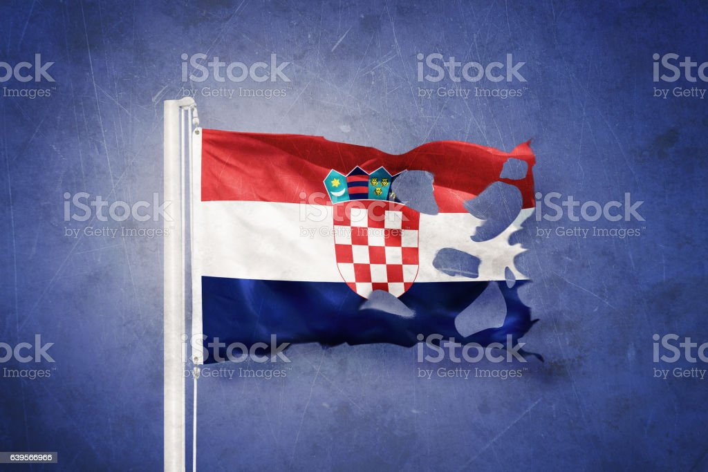 Torn flag of Croatia flying against grunge background - foto de stock