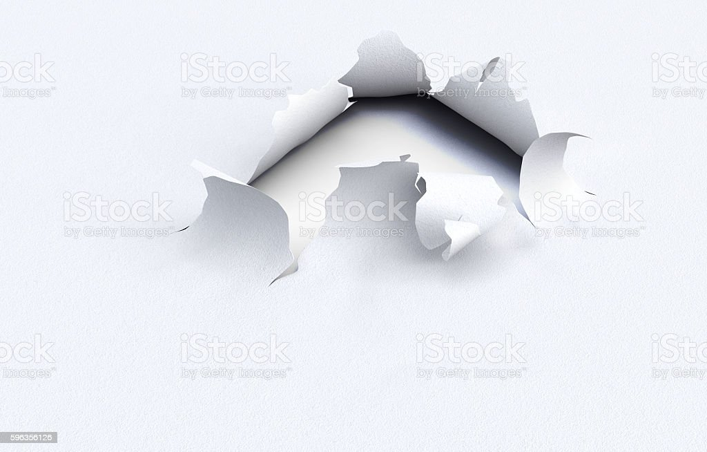 Torn hole in the kraft paper on a white background. royalty-free stock photo