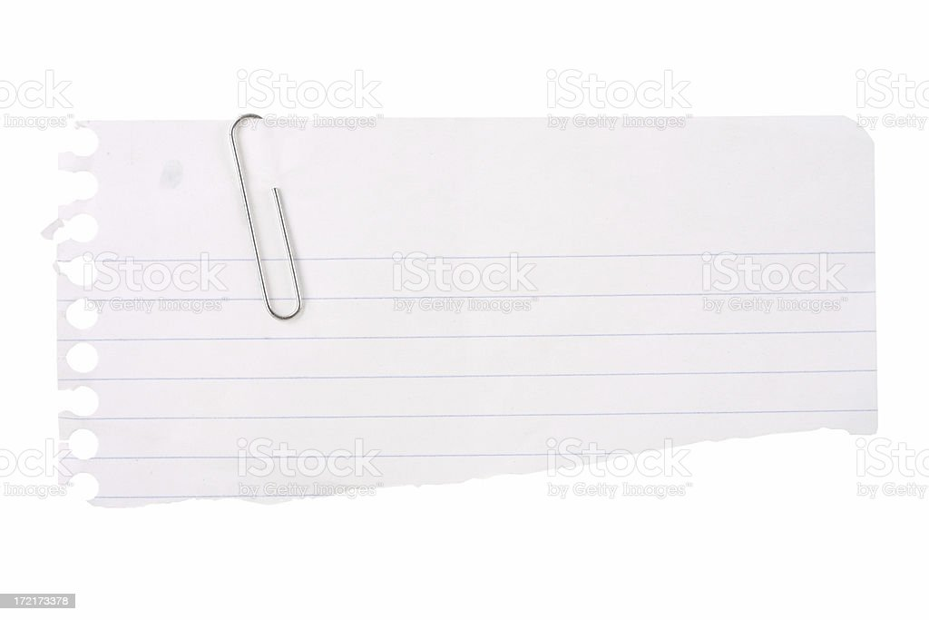 Torn Notebook Paper with Paperclip royalty-free stock photo
