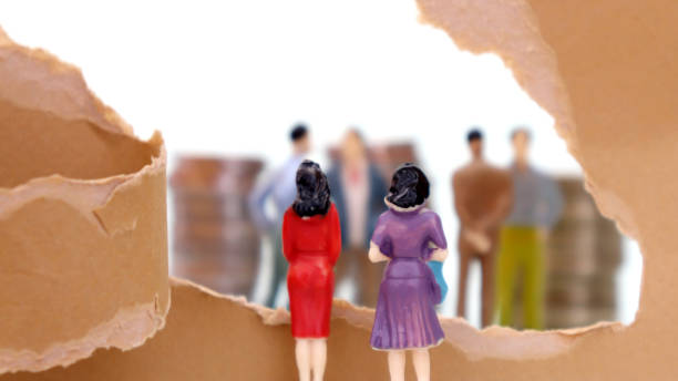 Torn paper and miniature people. A male-oriented corporate structure concept. Torn paper and miniature people. A male-oriented corporate structure concept. discriminatory stock pictures, royalty-free photos & images