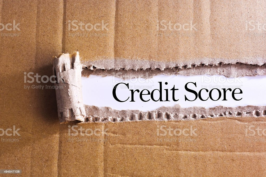 Torn paper box with word Credit score stock photo