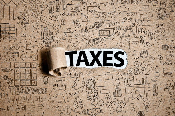 TAXES  /  Torn Paper Concept (Click for more) stock photo