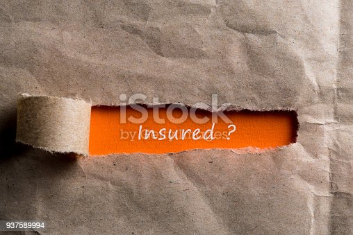 istock Torn paper envelope with question - insured. Insurance concept 937589994