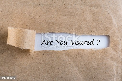 istock Torn paper envelope with word are you insured. Insurance concept 937589970