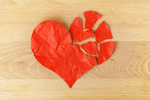 torn paper heart bildbanksfoto