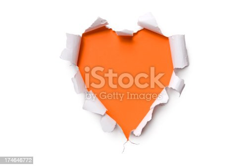 White torn paper in a heart shape over orange background.