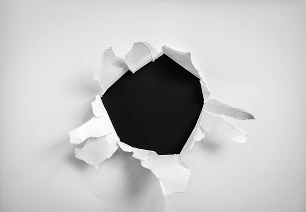 Torn paper hole Torn paper hole emergence stock pictures, royalty-free photos & images