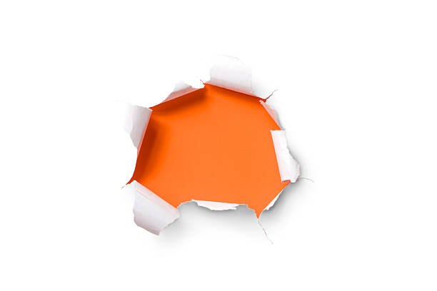 Torn paper hole. Tearing Inside Discovery through Emergence Orange White torn paper over orange background. emergence stock pictures, royalty-free photos & images