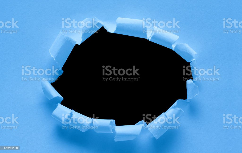 Torn paper hole textured background royalty-free stock photo