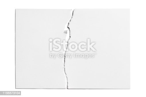 Sheet of paper torn in half, isolated on white background