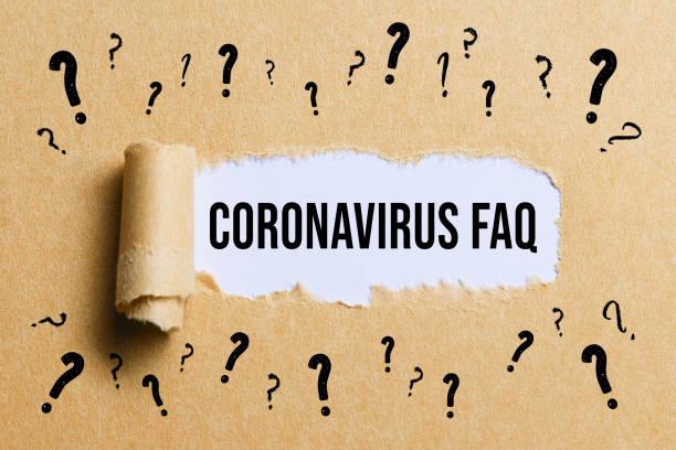 zerrissenes Papier mit dem Text CORONAVIRUS-FAQ – Foto