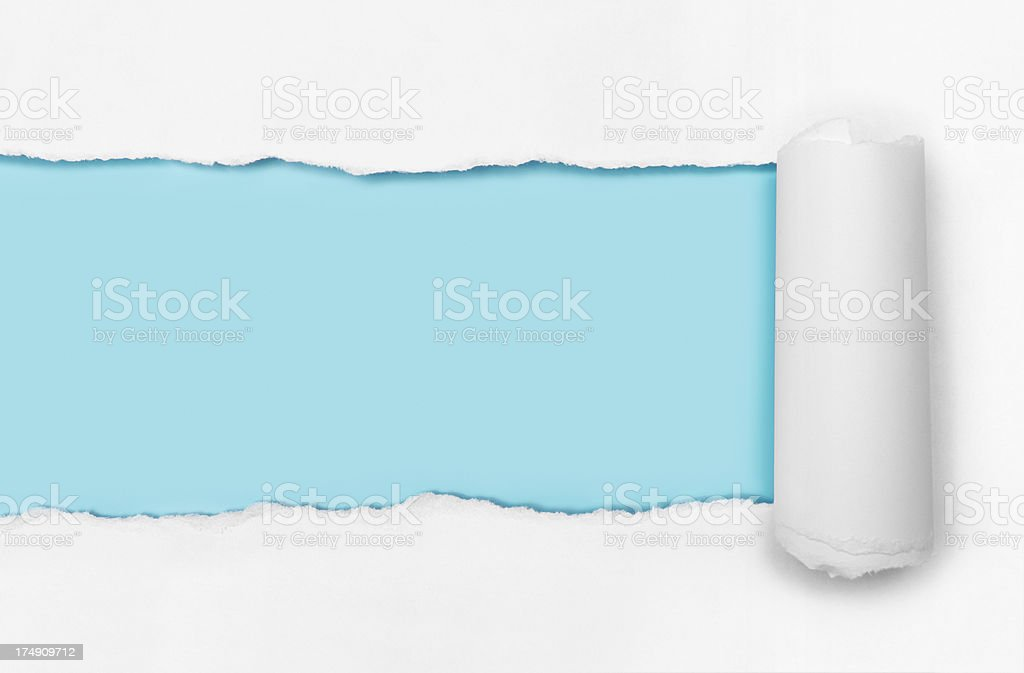 Torn paper with blue background stock photo