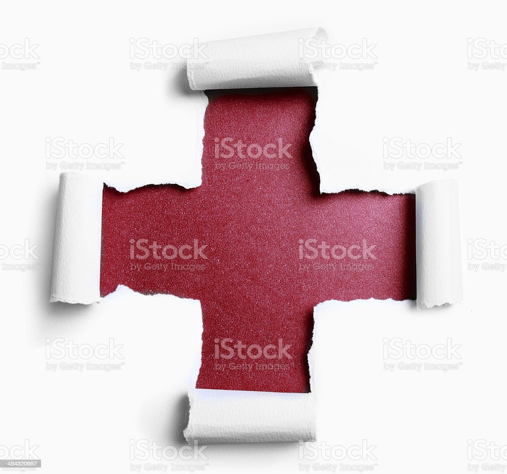 Torn paper with plus shape stock photo