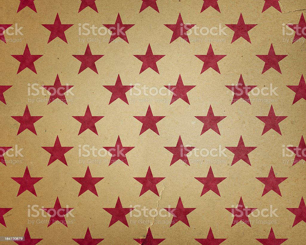 torn paper with red stars stock photo