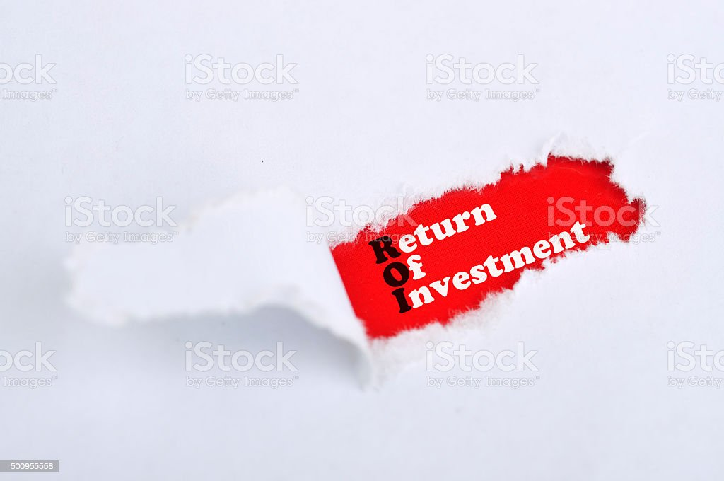 Torn Paper with Word 'Return Of Investment' stock photo