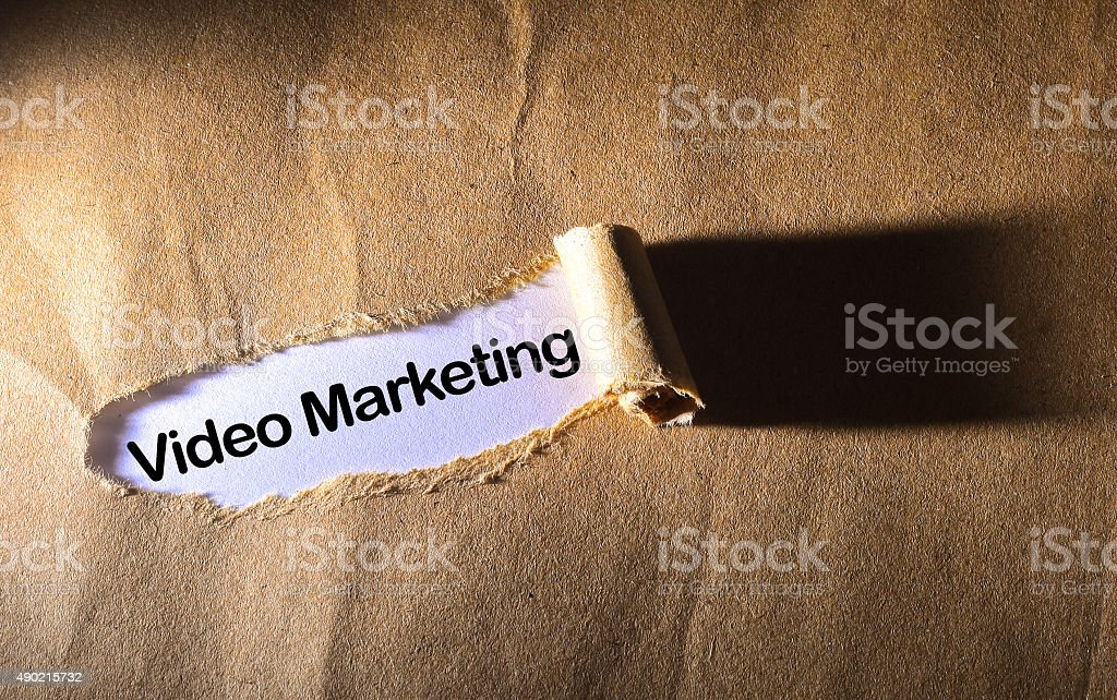 torn paper with word video marketing stock photo