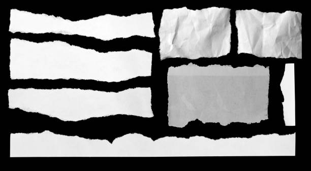 Torn papers on black stock photo