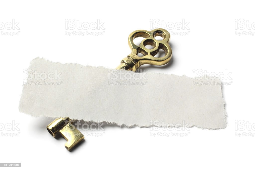 Torn Piece of Paper and Antique Key stock photo