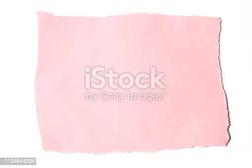 istock A torn piece of pink paper on a white background. 1134644204