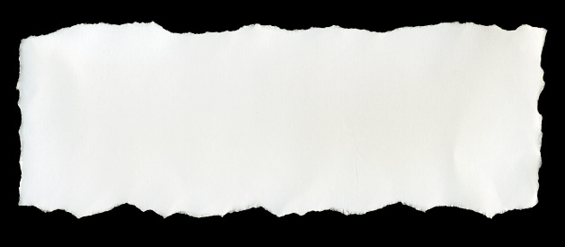 istock A torn piece of white paper on a black background 471247363