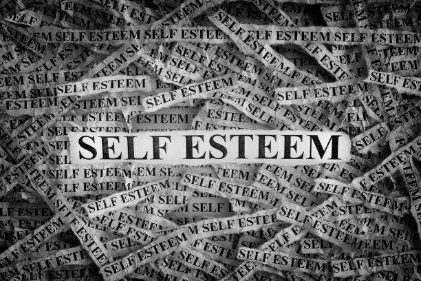 Torn pieces of paper with the words Self Esteem Self Esteem. Torn pieces of paper with the words Self Esteem. Concept Image. Black and White. Closeup. low self esteem stock pictures, royalty-free photos & images