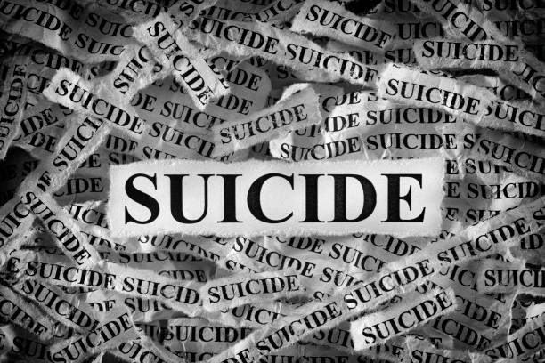 Torn pieces of paper with the words Suicide Suicide. Torn pieces of paper with the words Suicide. Black and White. Close up. suicide stock pictures, royalty-free photos & images